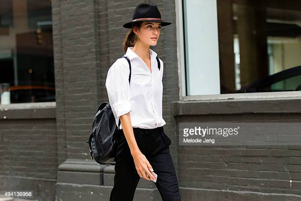 Dutch model Lis Van Velthoven exits the Tibi show at The Waterfront Building on September 12 2015 in New York City Lis wears a black brimmed hat with...