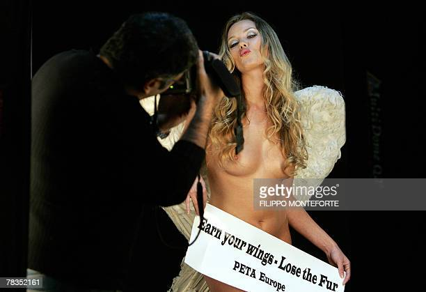 Dutch model Natasja Vermeer is pictured by Italian photographer Angelo Gigli while posing naked for animal rights campaign organized by The People...