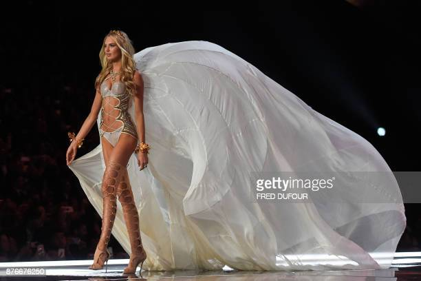 TOPSHOT Dutch model Romee Strijd presents a creation during the 2017 Victoria's Secret Fashion Show in Shanghai on November 20 2017 / AFP PHOTO /...