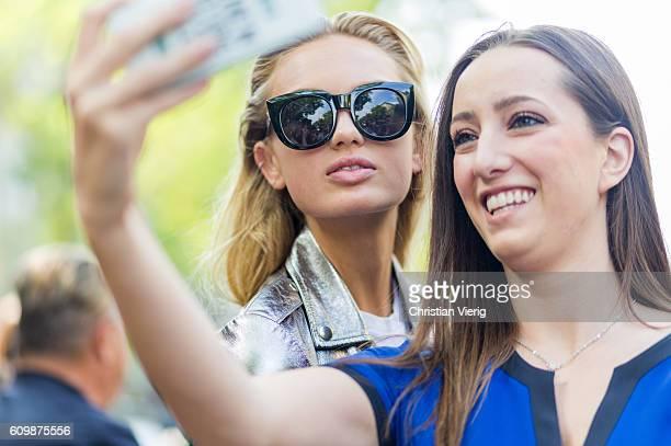 Dutch model Romee Strijd taking selfies with a fan outside Fendi during Milan Fashion Week Spring/Summer 2017 on September 22 2016 in Milan Italy