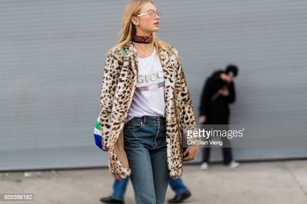 Dutch model Romee Strijd wearing a Gucci tshirt leopard print kaclet cropped denim jeans ankle boots outside Tory Burch on February 14 2017 in New...