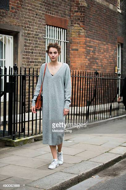 Dutch model Romy Schonberger wears a long cashmere sweater dress and white Adidas Stan Smith sneakers during London Fashion Week Spring Summer 2016...