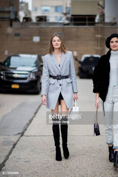Dutch model Sanne Vloet wearing grey blazer jacket belt seen outside Ralph Lauren on February 12 2018 in New York City