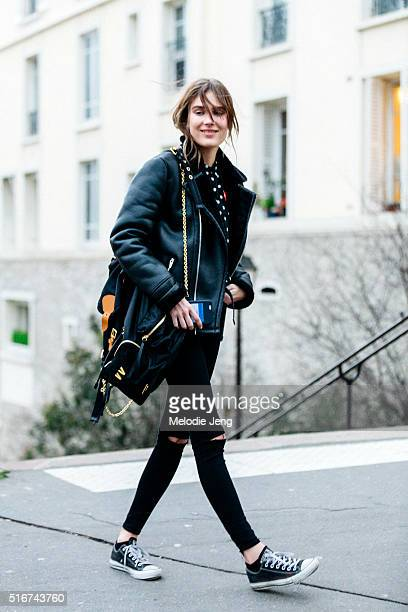 Dutch model Vera Van Erp wears a black shearling leather jacket Commes des Garcons Play polkadot top black skinny jeans with open knees black...