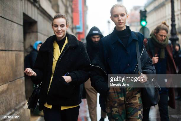 Dutch models Estella Brons and Jessie Bloemendaal after the Poiret show on March 04 2018 in Paris France Estella wears a black jacket with a yellow...