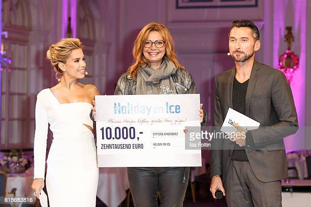 Dutch moderator Sylvie Meis, german actress Maren Gilzer and german moderator Stephan Jaekel attend the 'Holiday on Ice' gala at Hotel Atlantic on...