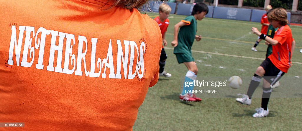 A Dutch mother watches young football players during the Mini World Cup 2010 in Hong Kong on June 6, 2010. The South Africa 2010 World Cup will start on June 11.