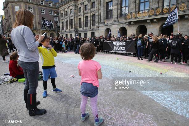Dutch mothers with their children paint Rainbow Of Hope for the climate and Anonymous for the Voiceless join at the Dam square on May 12, 2019 in...