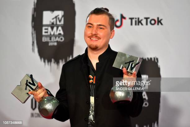 Dutch music producer Jack $hirak poses with his awards backstage during the MTV Europe Music Awards at the Bizkaia Arena in the northern Spanish city...