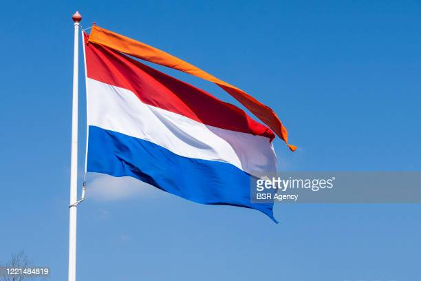 Dutch national flag with an orange banner is seen on King's Day amid the coronavirus outbreak on April 27, 2020 in Drachten, Netherlands. Due to the...