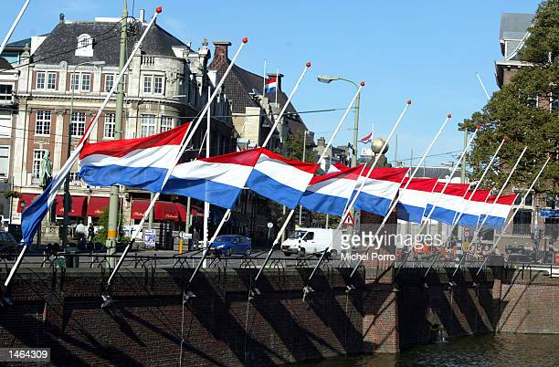 Dutch national flags hang half mast October 8 2002 in The Hague The Netherlands Prince Claus husband to Queen Beatrix died October 6 2002 after a...