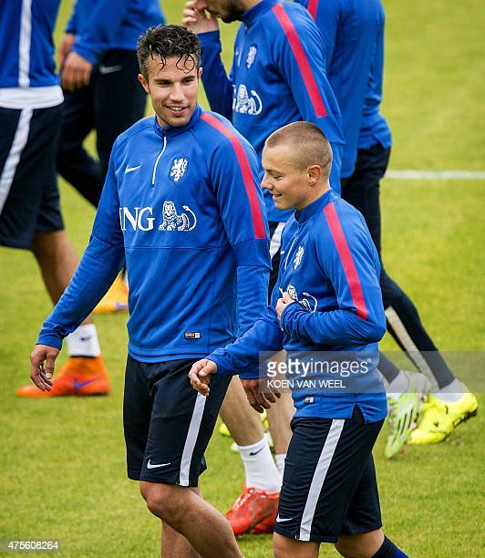 Dutch National football team players Jordy Clasie and Robin van Persie speaks during a training session in Hoenderloo on June 2 three days ahead of a...
