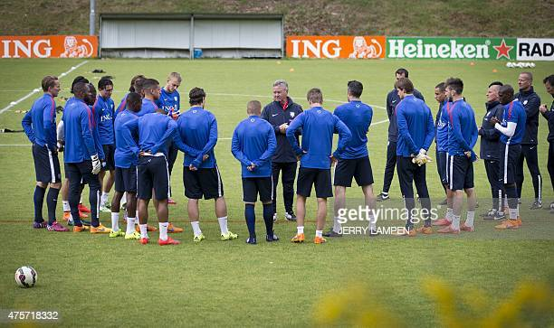 Dutch national soccer team coach Guus Hiddink speaks to his players during a training session in Hoenderloo on June 3 2015 The Dutch team will face...