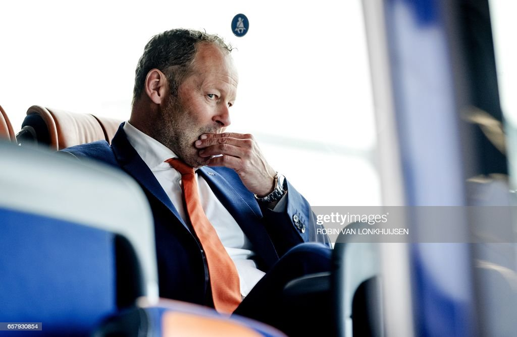 Dutch national soccer team head coach Danny Blind arrives at Schiphol Airport in Amsterdam on March 26, 2017 a day after the FIFA World Cup 2018 qualifying group A football match between Bulgaria and the Netherlands in Sofia. / AFP PHOTO / ANP / Robin van Lonkhuijsen / Netherlands OUT