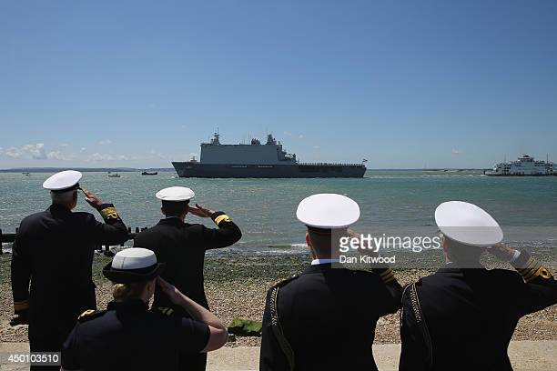 Dutch Naval Officers salute as the HNLMS Joan de Witte sails past Southsea Common during a commemoration of the DDay landings on June 5 2014 in...