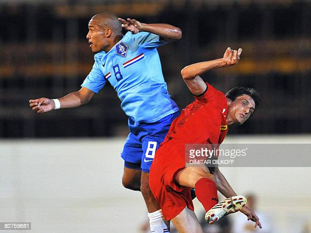 Dutch Nigel De Jong vies for the ball with Macedonia's Goran Maznov during their FIFA World Cup 2010 qualifying football match on September 10 2008...