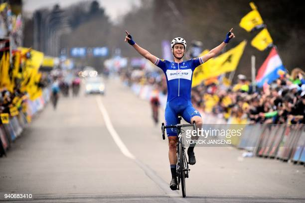 Dutch Niki Terpstra of Quick-Step Floors celebrates as he crosses the finish line to win the 102nd edition of the 'Ronde van Vlaanderen - Tour des...