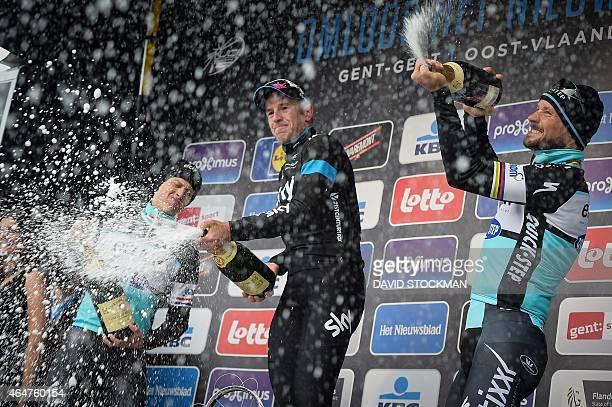 Dutch Niki Terpstra of team Ettix QuickStep British Ian Stannard of Team Sky and Belgian Tom Boonen of team Ettix QuickStep celebrate on the podium...