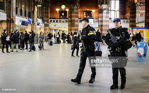 Dutch officers carry out extra patrols at the Central Station in Amsterdam The Netherlands 22 March 2016 following the triple bomb attacks in the...