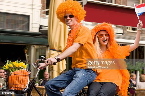 dutch orange queensday folklore mayhem - king's day netherlands stock pictures, royalty-free photos & images