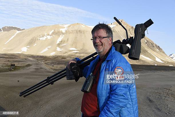 Dutch ornithologist Maarten Loonen specialist of the Artic terns and Barnacle geese poses as he walks in the scientific base of Ny Alesund in the...