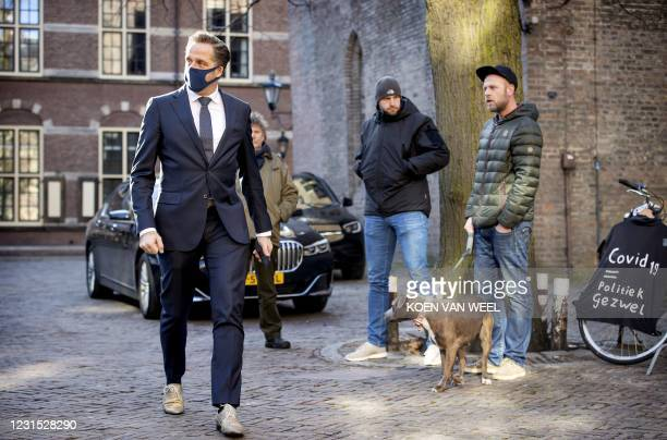 Dutch outgoing Minister of Health, Welfare and Sport Hugo de Jonge arrives at the Binnenhof for the weekly Council of Ministers meeting in The Hague...