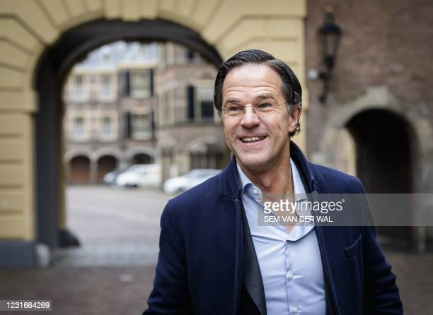 Dutch outgoing Prime Minister Mark Rutte arrives at the Binnenhof in The Hague for the weekly Council of Ministers on March 12, 2021. - Netherlands...