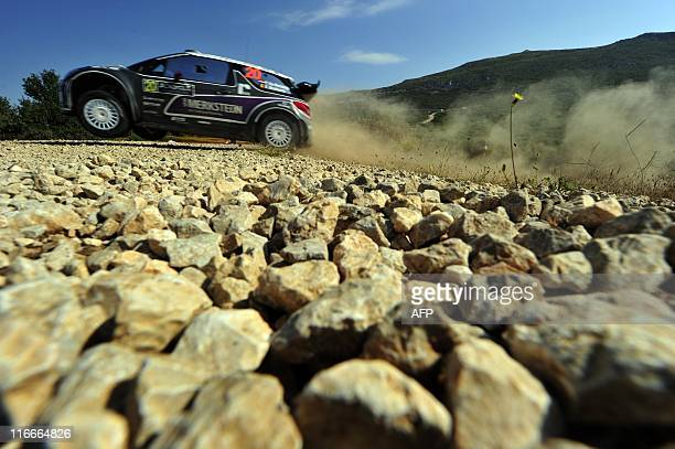 Dutch Peter Van Merksteijn with his codriver Erwin Mombaerts drive their Citroen DS3 WRC during the 2011 Acropolis rally at Thiva special stage on...