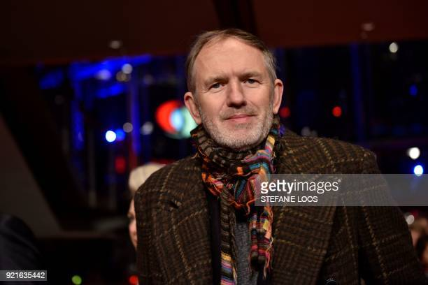 Dutch photographer Anton Corbijn poses as he arrives for a ceremony to award US actor Willem Dafoe with the Honorary Golden Bear prize on February 20...