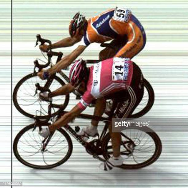 Dutch Pieter Weening crosses first the finish line ahead of German Andreas Kloden at the end of the eighth stage of the 92nd Tour de France cycling...
