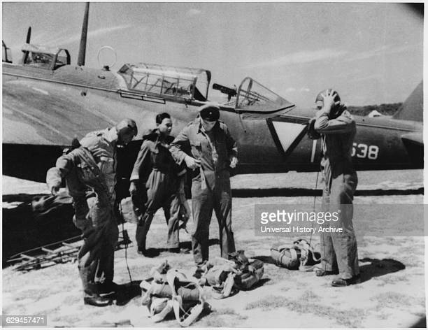 Dutch Pilots Putting on Gear Near Airplane as they Prepare for Air Raid on Japanese Forces During WWII Dutch East Indies 1942