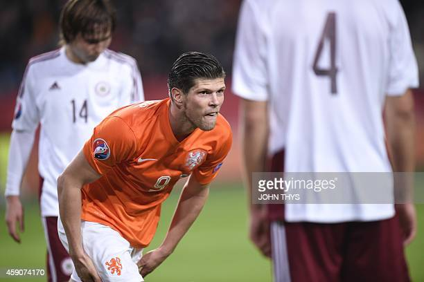 Dutch player KlaasJan Huntelaar celebrates after scoring during the Euro 2016 qualifying round football match between the Netherlands and Latvia at...