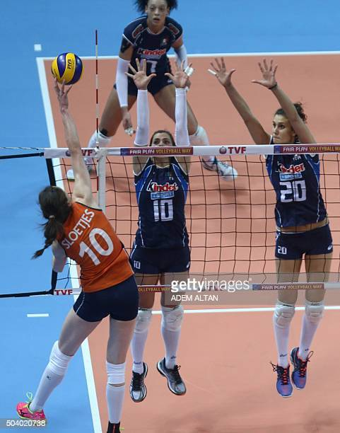 Dutch player Lonneke Sloetjes smashes as Italian volleyball players Valentina Diouf Francesca Ferretti and Anna Danesi attempt to block during the...