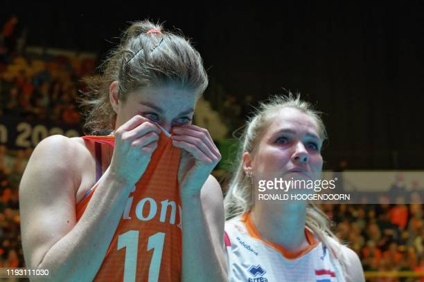 Dutch players Anne Buijs and Kirsten Knip react after loosing in the semifinal of the women's Tokyo 2020 Volleyball Qualification match against...