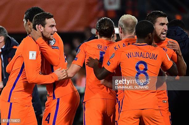 Dutch players celebrate after scoring during the Fifa World Cup 2018 football qualification match between The Netherlands and Belarus at Feyenoord...