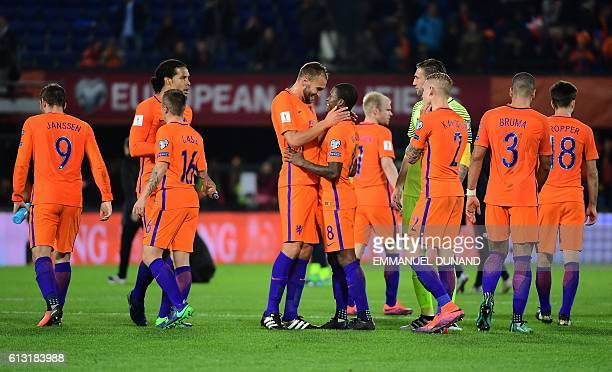 Dutch players celebrate after their team's victory during the Fifa World Cup 2018 football qualification match between The Netherlands and Belarus at...