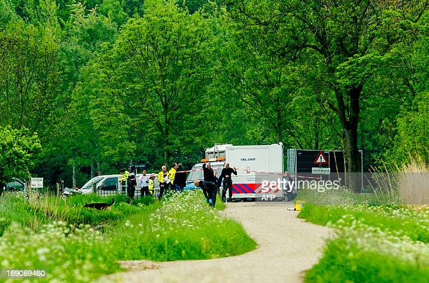 Dutch police closes off an area near Cothen on May 19 where two bodies were found earlier today The location is close to the place where the father...