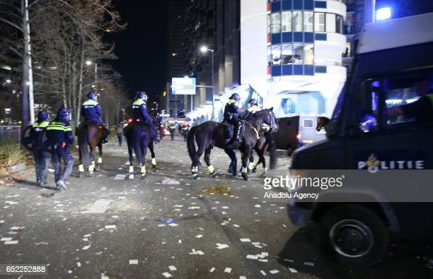 Dutch police officers including mounted policemen intervene the Turkish citizens gathering outside Turkish consulate in Rotterdam to protest Dutch...
