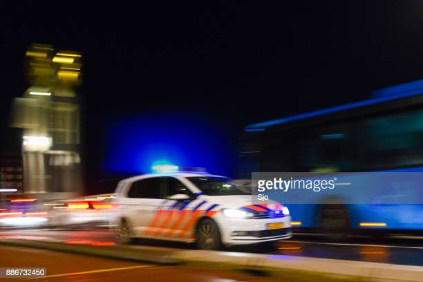 dutch policecar rushing to the scene of an accident - police force stock pictures, royalty-free photos & images