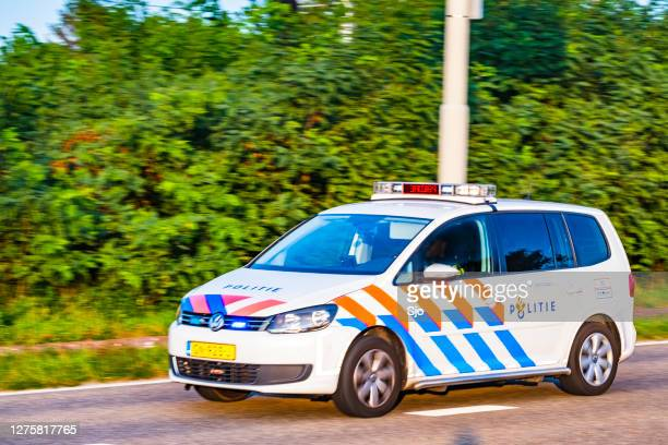 dutch policecar rushing to the scene of an incident - overijssel stock pictures, royalty-free photos & images