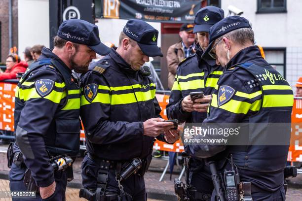 dutch policeman in uniform are active during koningsdag in amersfoort-2019 - amersfoort netherlands stock photos and pictures