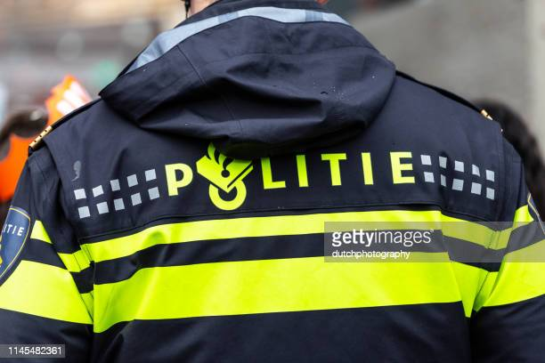 dutch policeman in uniform - police force stock pictures, royalty-free photos & images