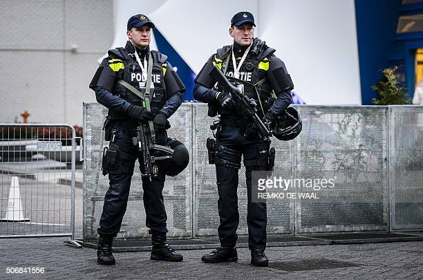 Dutch policemen holding machine guns stand guard near the Scheepsvaartmuseum in Amsterdam on January 26 during an informal meeting of the EUministers...