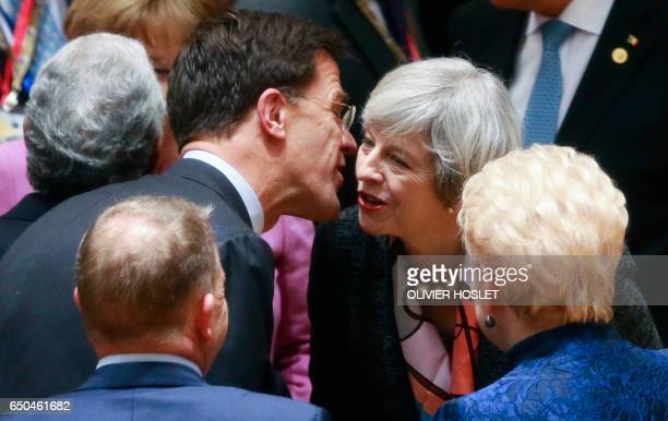 Dutch Prime Minister Mark Rutte and Britain's Prime Minister Theresa May speak during the EU summit at the new Europa building in Brussels on March 9...