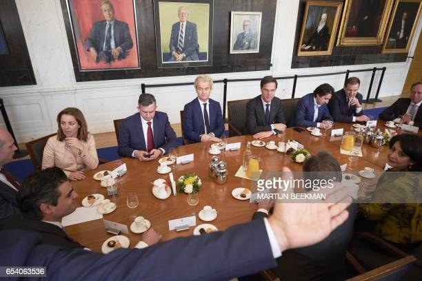 TOPSHOT Dutch Prime Minister Mark Rutte and Dutch PVV leader Geert Wilders pose with other party leaders prior to a meeting with the Chairman of the...