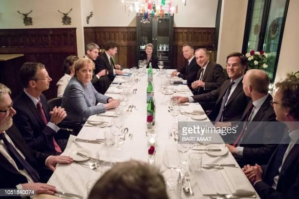 Dutch Prime Minister Mark Rutte and German Chancellor Angela Merkel attend a dinner in restaurant Allard in The Hague, the Netherlands, on October...
