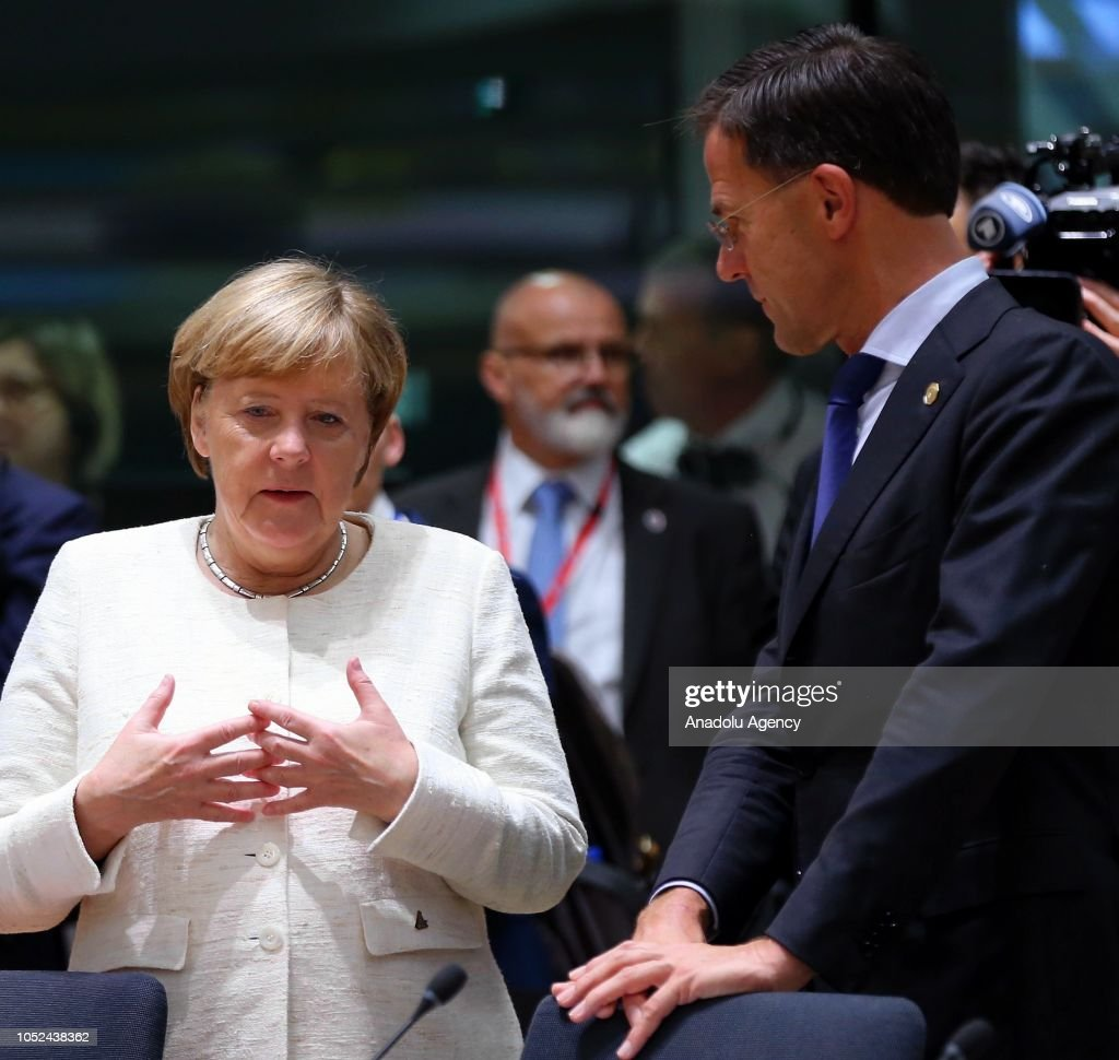 Maurits Hendriks Netherlands Prime Minister Mark Rutte L: Dutch Prime Minister Mark Rutte And German Chancellor