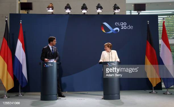 Dutch Prime Minister Mark Rutte and German Chancellor Angela Merkel attend a news conference at the German federal Chancellery on July 09, 2020 in...