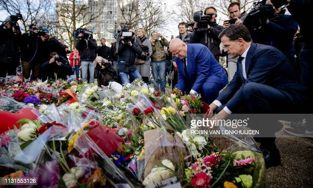 Dutch Prime Minister Mark Rutte and Minister of Justice and Security Ferdinand Grapperhaus place floral tributes near the scene of the fatal shooting...
