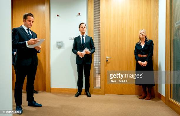 Dutch Prime Minister Mark Rutte and Ministerof Health, Welfare and Sport Hugo de Jonge stand prior to a press conference in The Hague, on January 12...